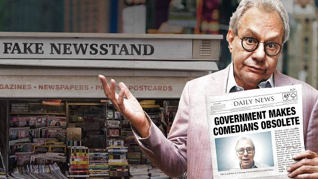 Photo of Lewis Black holding a fake newspaper
