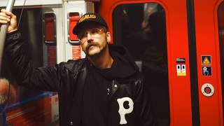 Photo of Portugal. The Man founder and lead singer John Gourley riding the subway