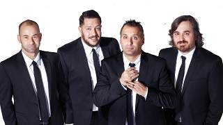 Impractical Jokers cast in black suits and long ties